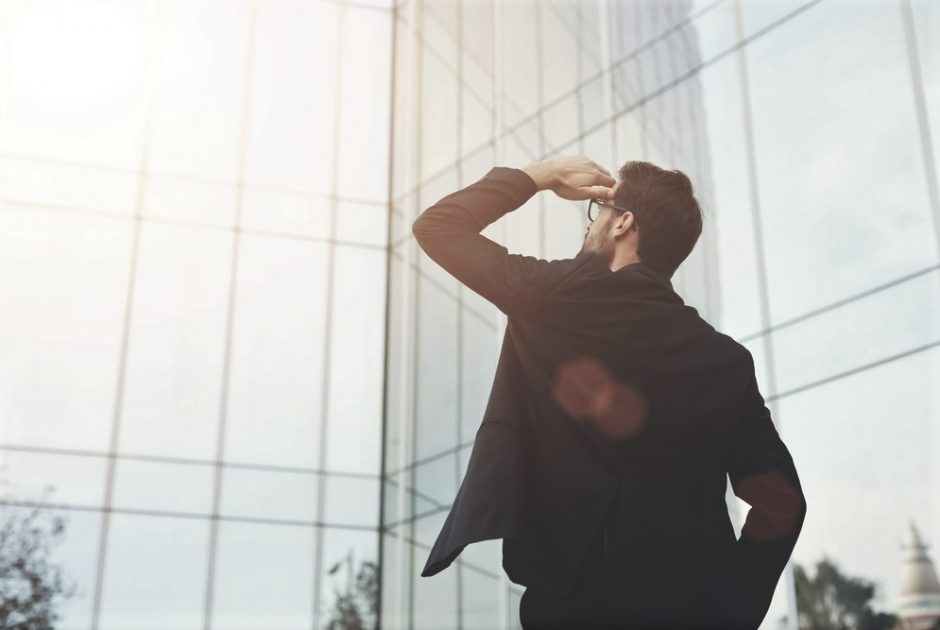 Back,View,Of,Successful,Man,Entrepreneur,Looking,Up,On,Modern